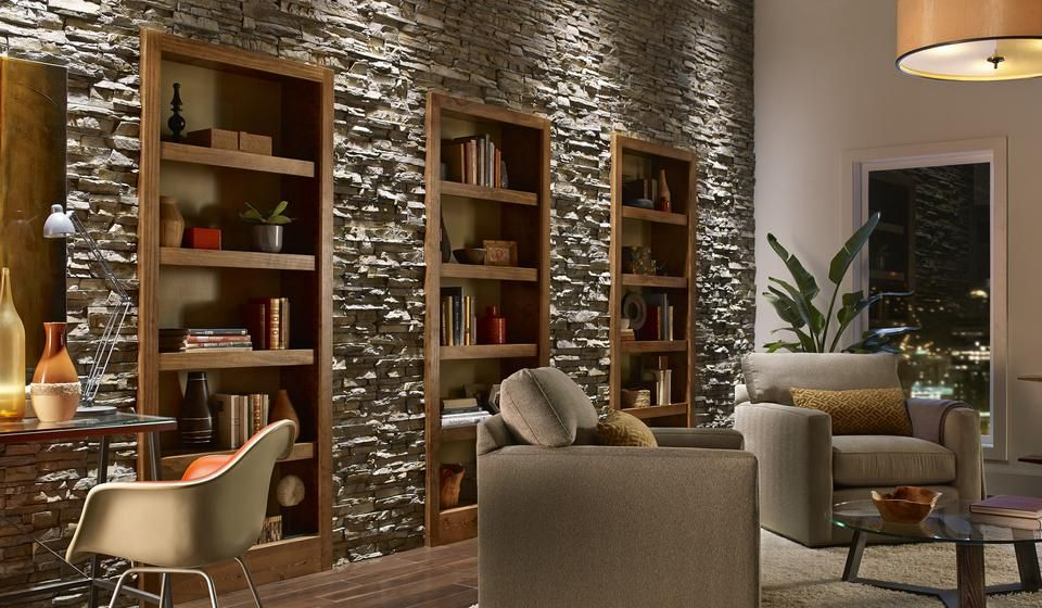 Contemporary Stone Wall Built In Bookcases Neutral Color Palette