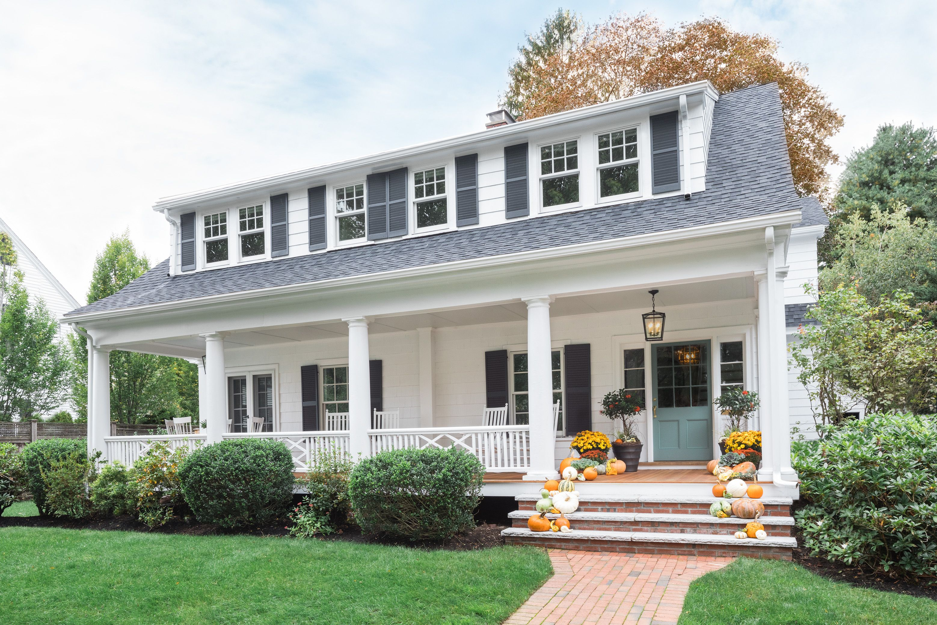 This 1915 Dutch Colonial In Winchester Ma Had A Welcoming Front Porch And Some Charming Ori Dutch Colonial Homes Colonial House Exteriors Colonial Style Homes