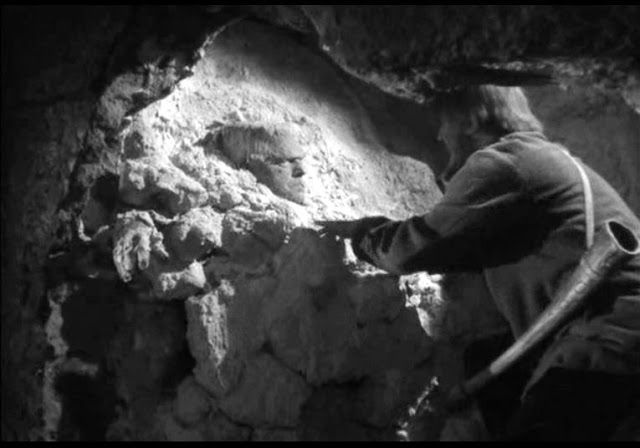 "Ygor rescues the Monster from the sulphur pit in ""The Ghost of Frankenstein"" (1942)"