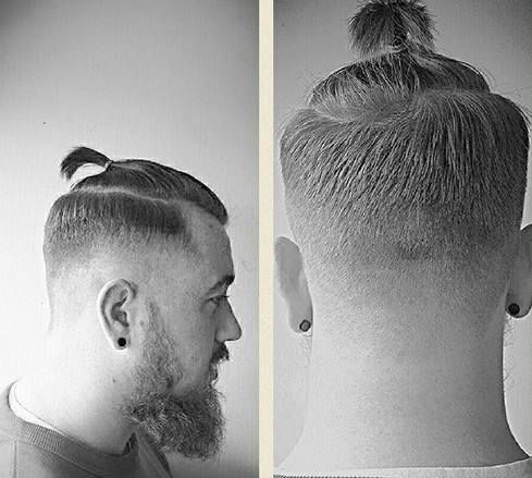 A picture of a male with a short ponytail which is commonly