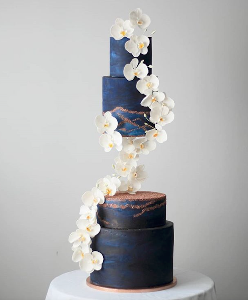 Midnight blue modern designed wedding cake made with Satin Ice | Sweet Creations Cakes #gravitycake