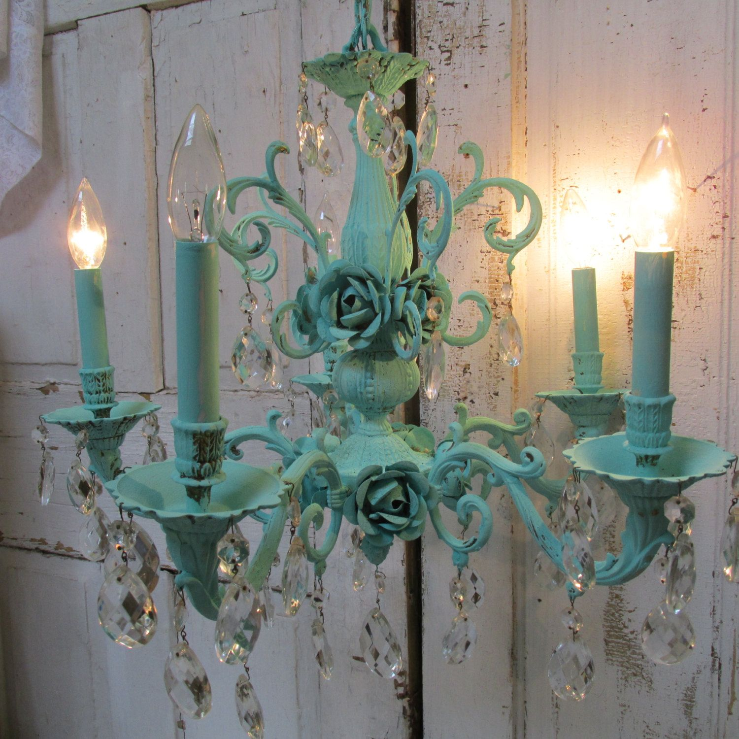 Ornate aqua chandelier with crystals embellished with cabbage