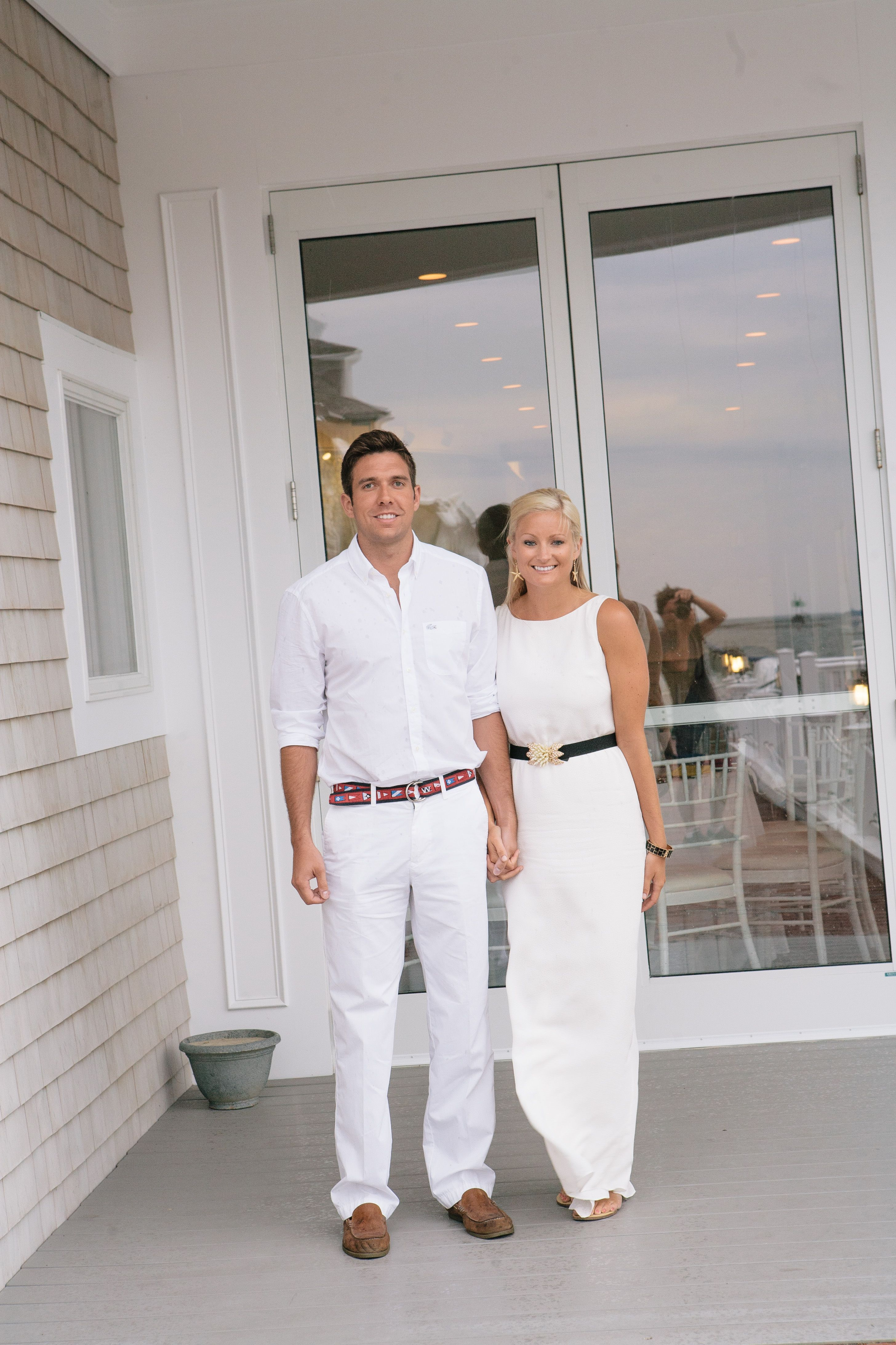 Bride And Groom Both Wear Casual White For The Rehearsal Dinner