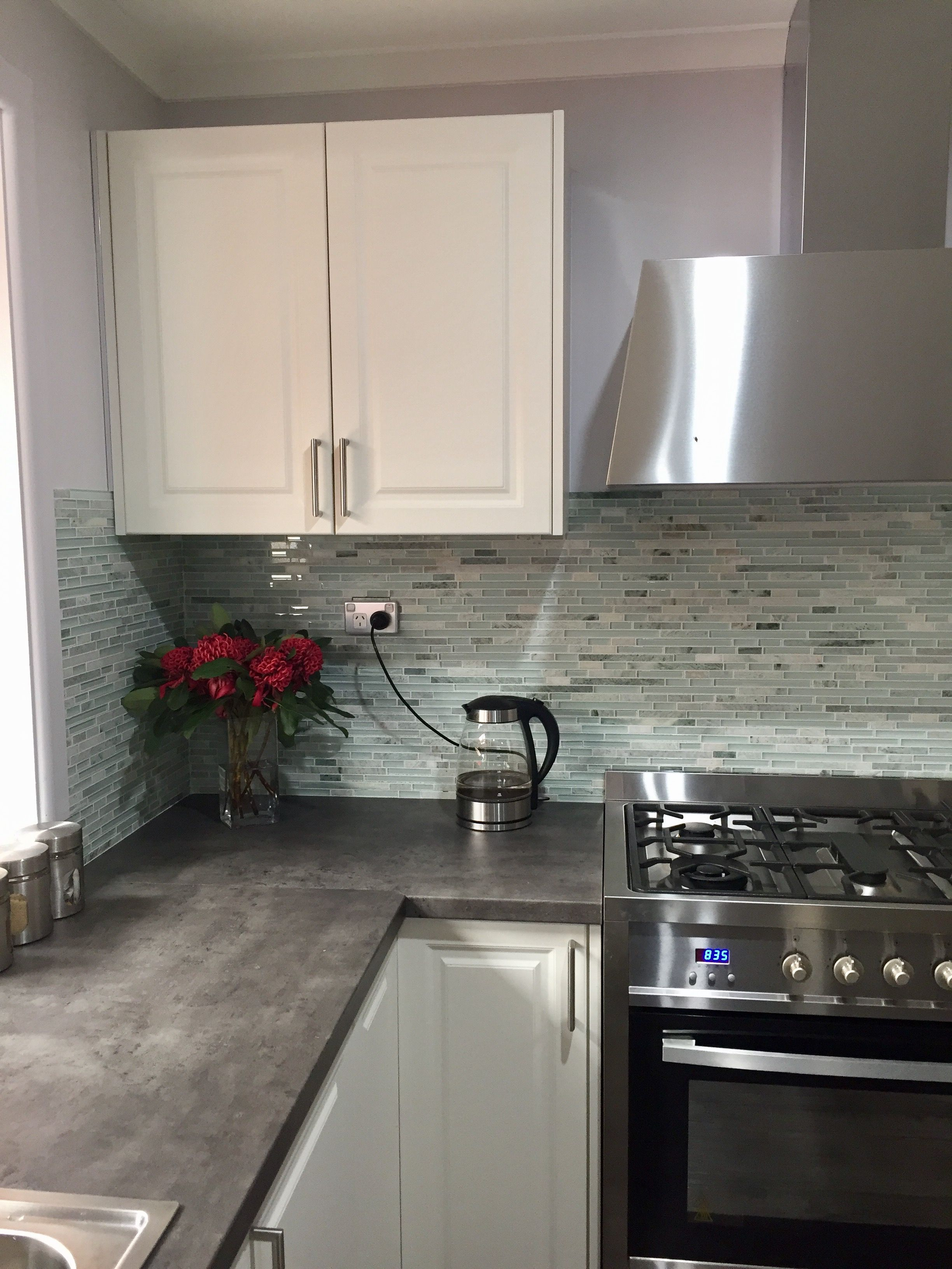 Mint marble tile and a Kaboodle kitchen present a pretty