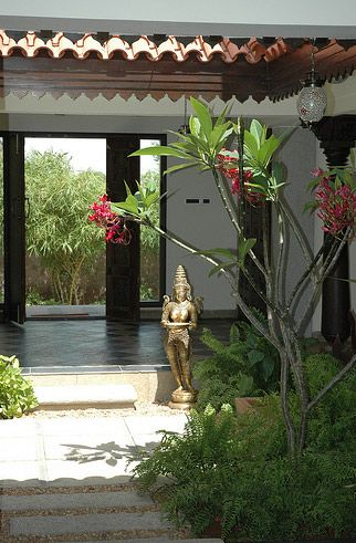 Spanish with asian blessings outside for Courtyard house designs india
