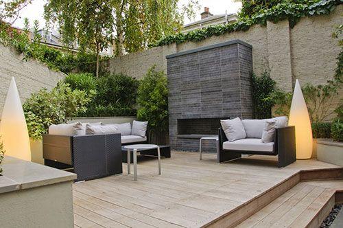 Een lounge tuin met een moderne loungeset klusopmaat