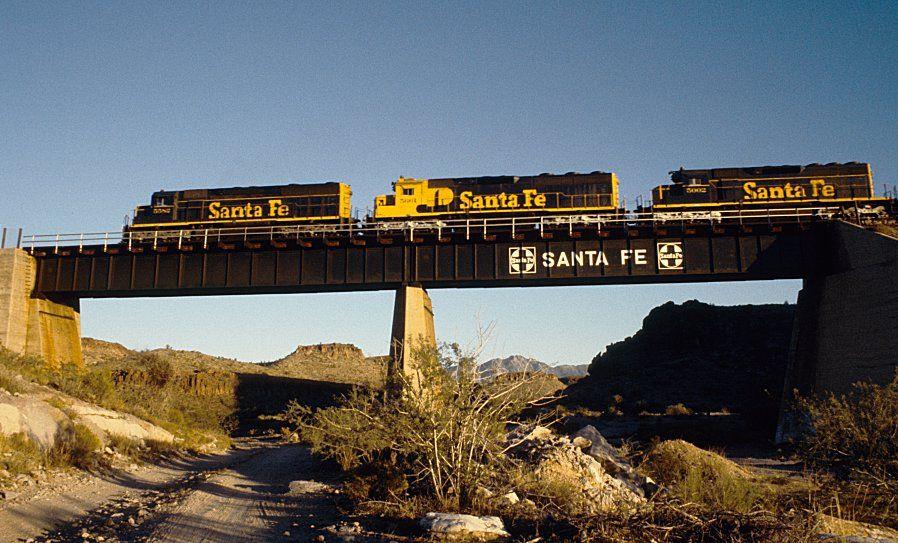 ATSF Railway train symbol 883 on deck girder bridge over
