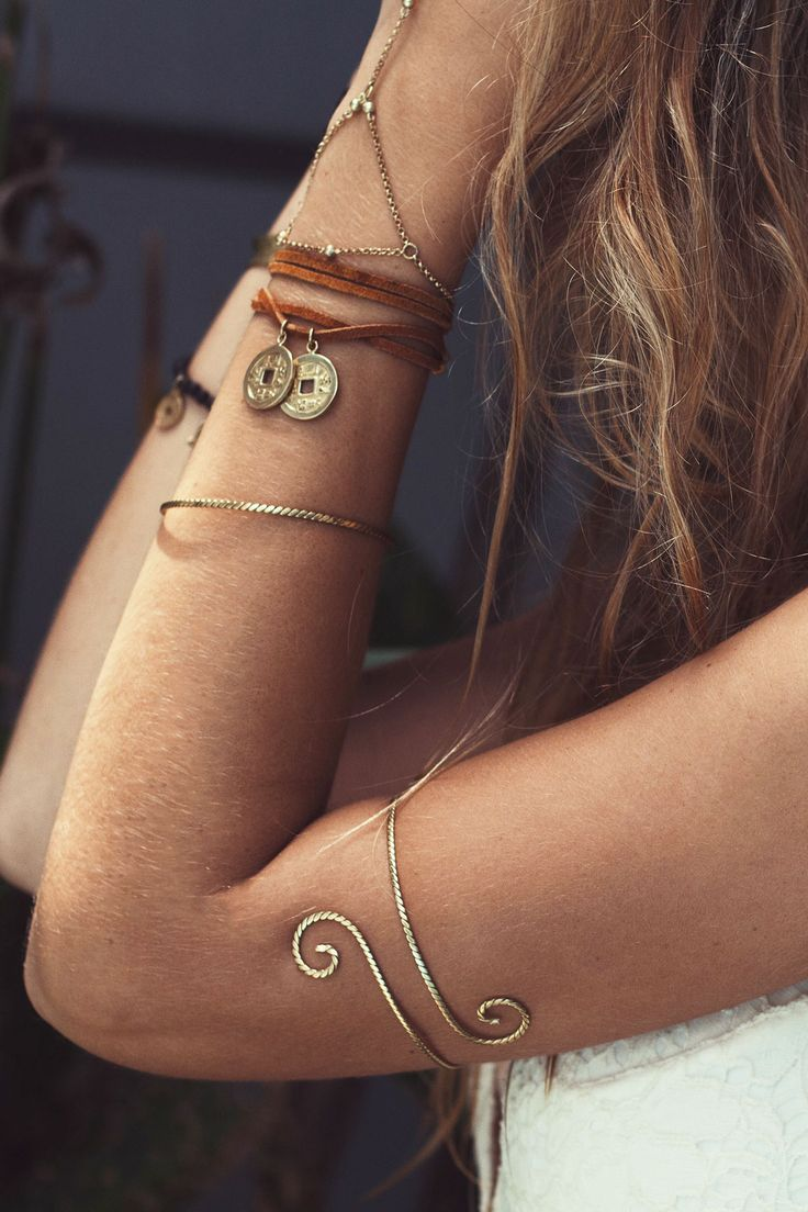 Photo of Ariella anaconda bracelet. Roh puts on bracelets. Juana Jari bracelet. Handmade
