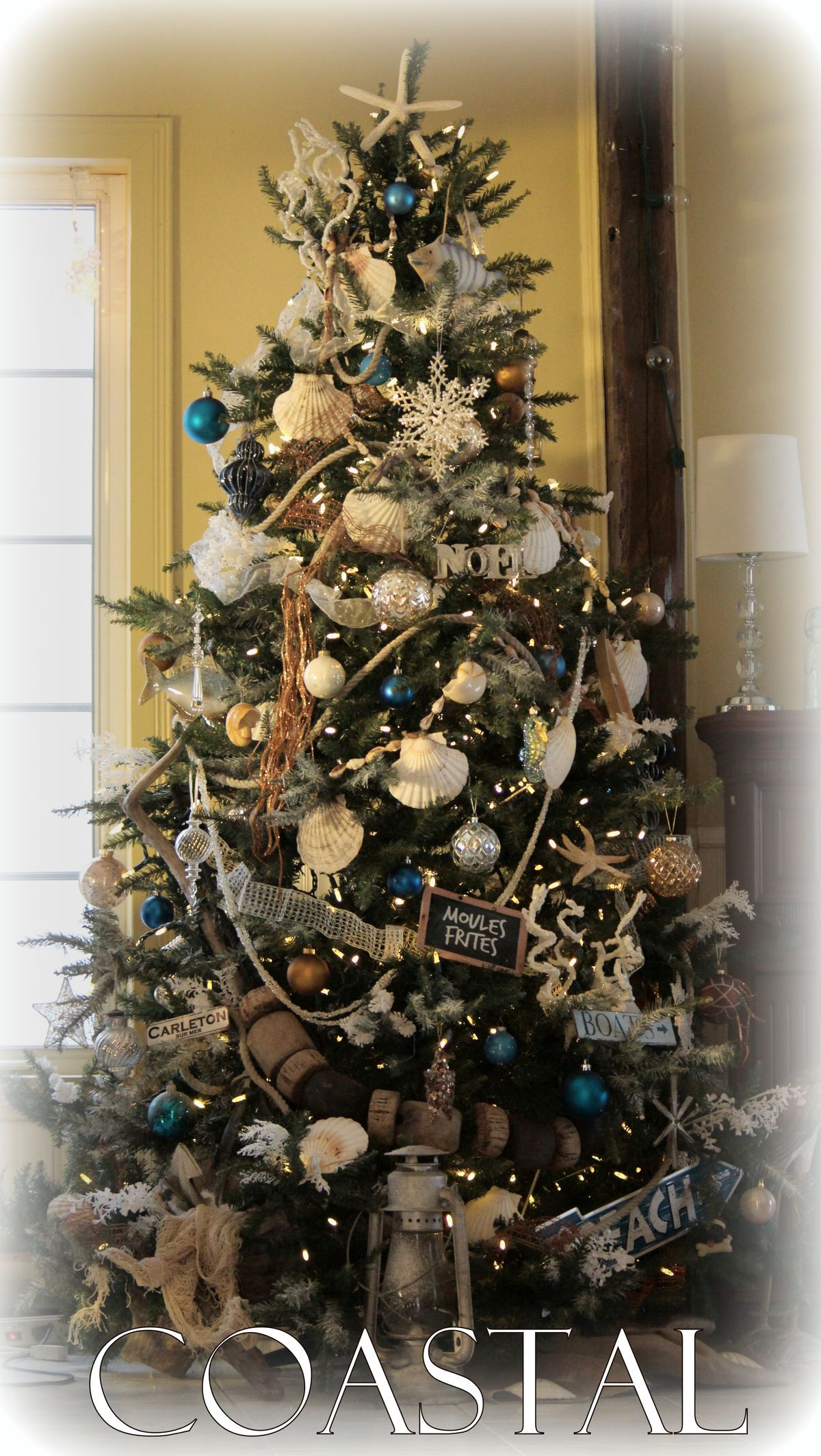 Christmas tree with shells, rope, anchor, beach theme signs, buoy float  garland