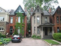 BAY-AND-GABLE: The most prominent feature is the large bay window that usually covers more than half of the front of the house, surmounted by a gable roof. The classic bay and gable is a red brick semi-detached structure that is two and a half stories tall, though many variations also exist. It was one of the most common forms of house built in late nineteenth and early twentieth century Toronto.