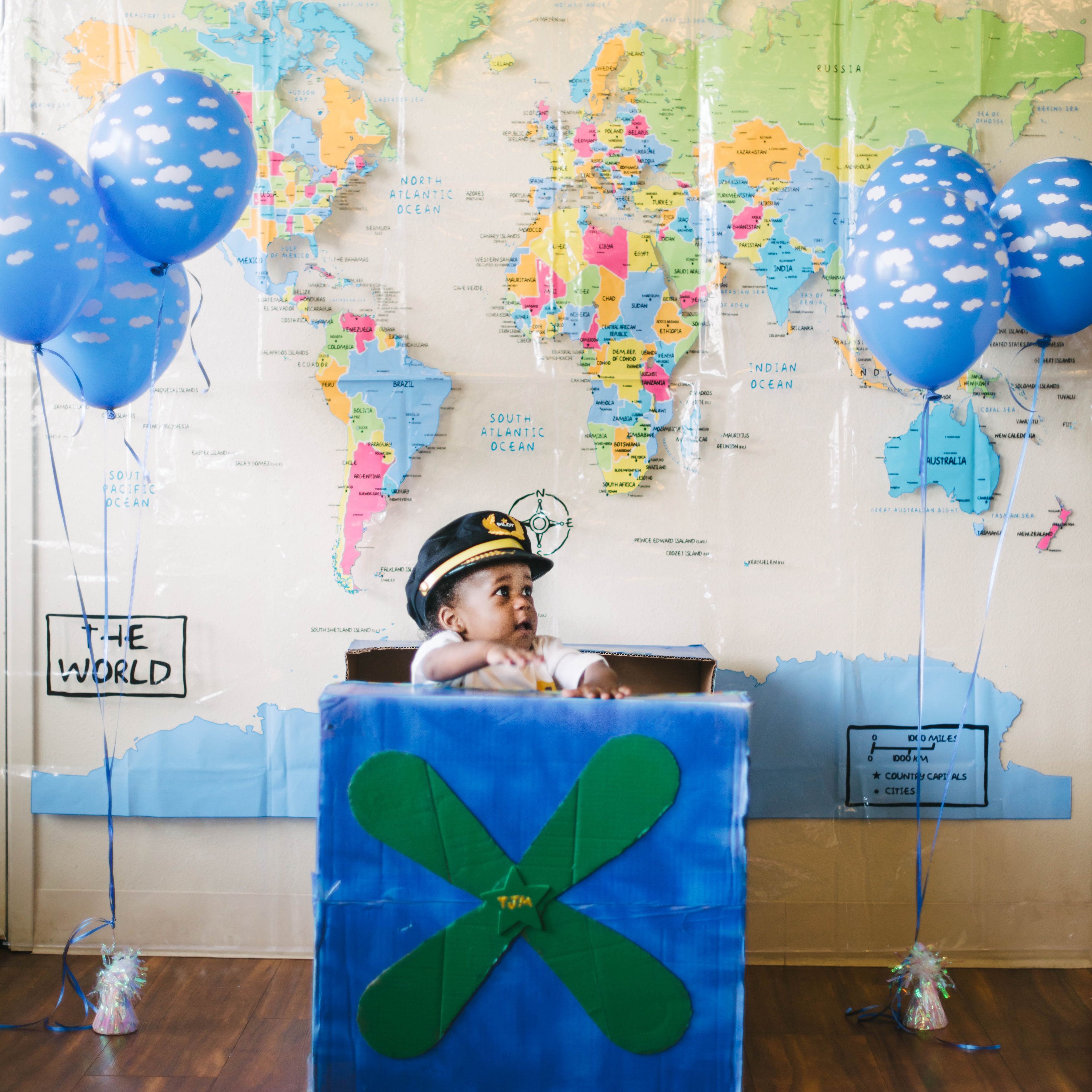Photobooth from travel themed first birthday party backdrop shower photobooth from travel themed first birthday party backdrop shower curtain of world map from gumiabroncs Choice Image