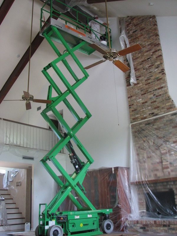 Painting A High Ceiling Can Involve Working In Difficult Heights Using Large Ladders And Even
