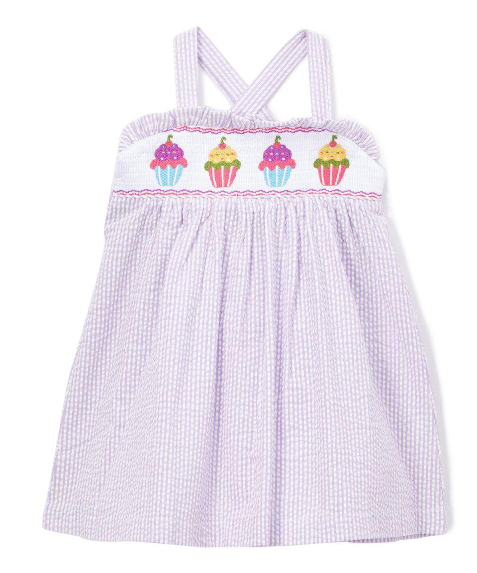 Take a look at this Lavender Seersucker Cake Smocked Dress - Infant, Toddler & Girls today!