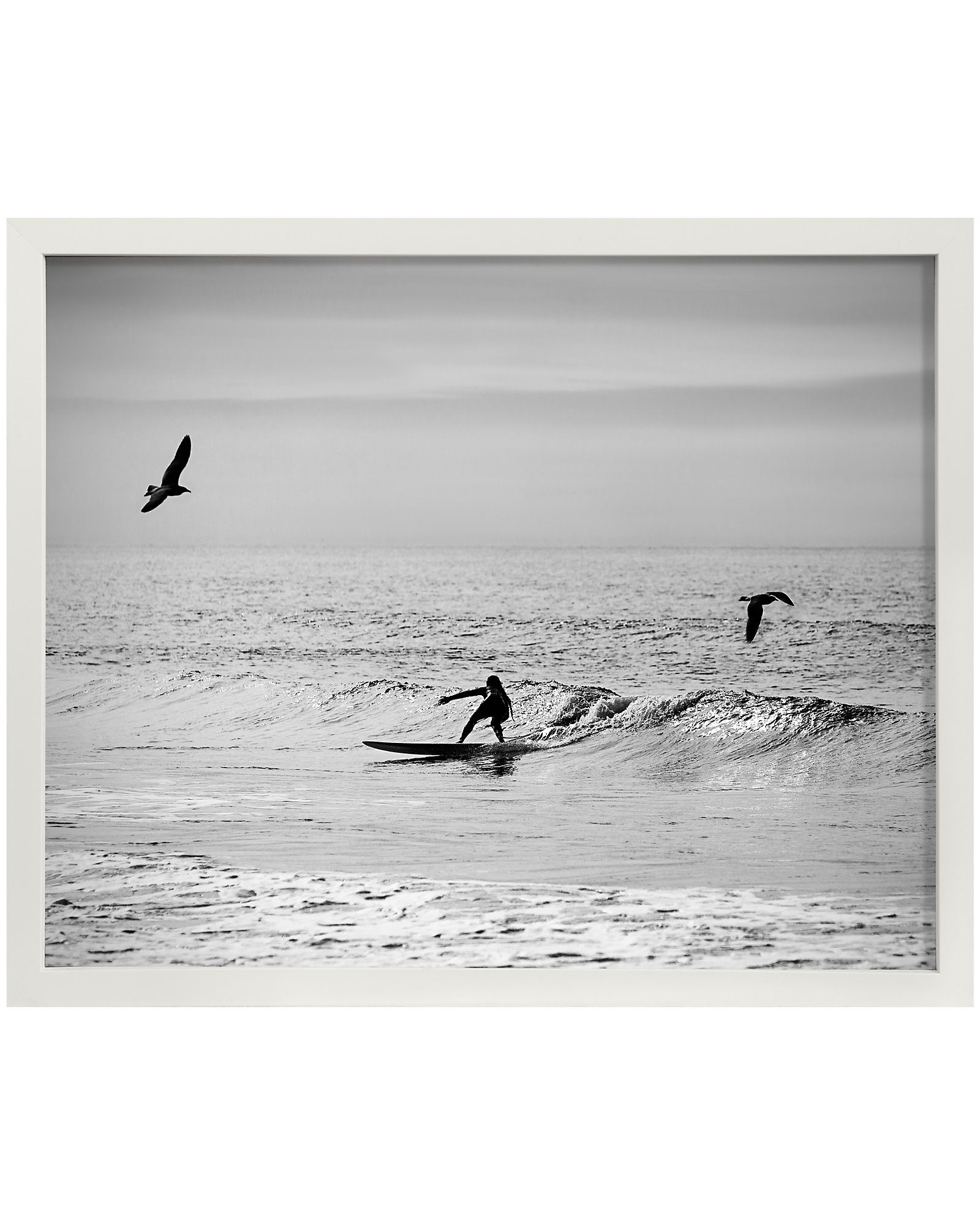 Photographic print mounted and framed in natural wood. 16.75\