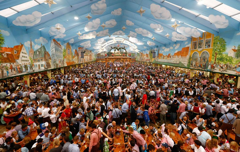 Celebrating Oktoberfest in a beer tent in Munich 9/22/12. ( & Celebrating Oktoberfest in a beer tent in Munich 9/22/12. (photo ...