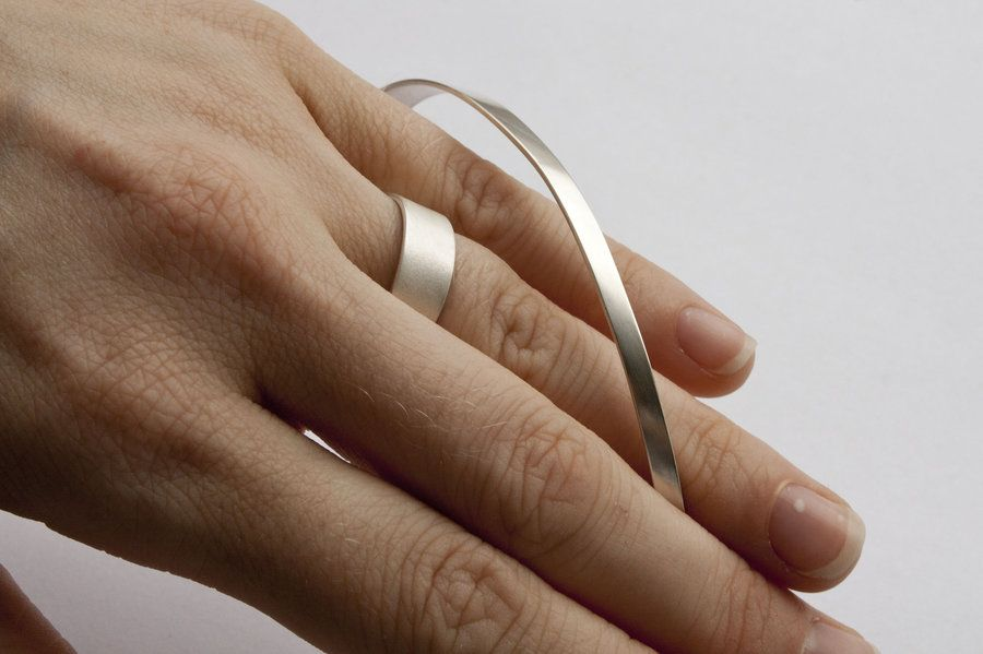 """a silver fabricated """"ribbon"""" ring."""