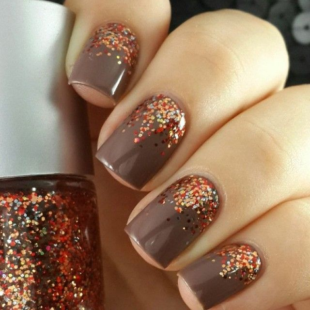 Brown nails with red, orange and gold glitter - the ...