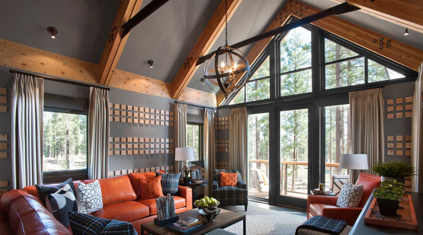 Love the ceiling and wall taupe-ey color along with the pops of orange in the living room ...