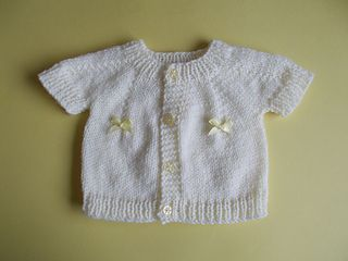 Photo of Top-Down Newborn Cardigan with Buttons & Bows pattern by marianna mel