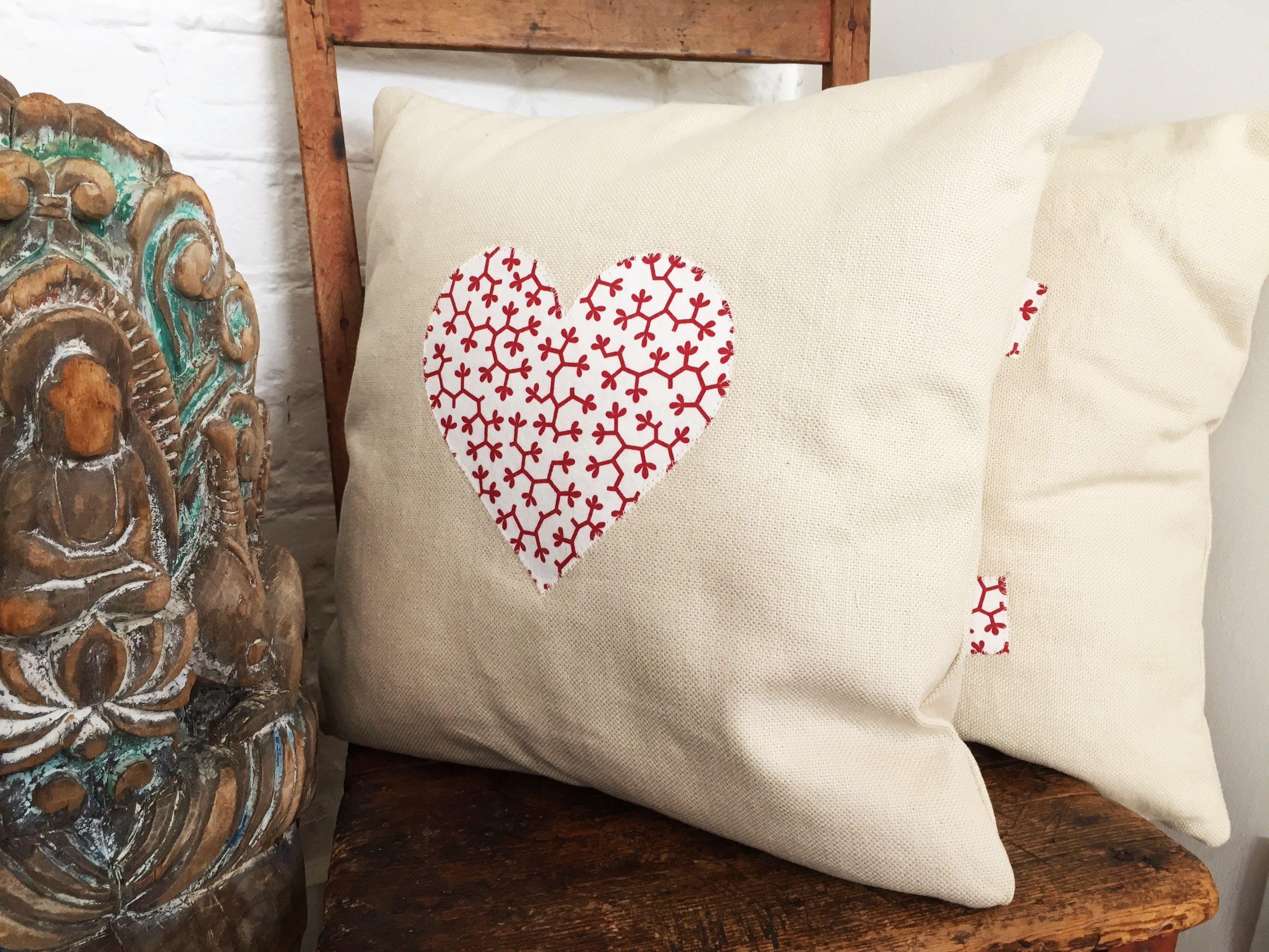 Beautiful cushion handmade with ian mankin fabric stitched heart
