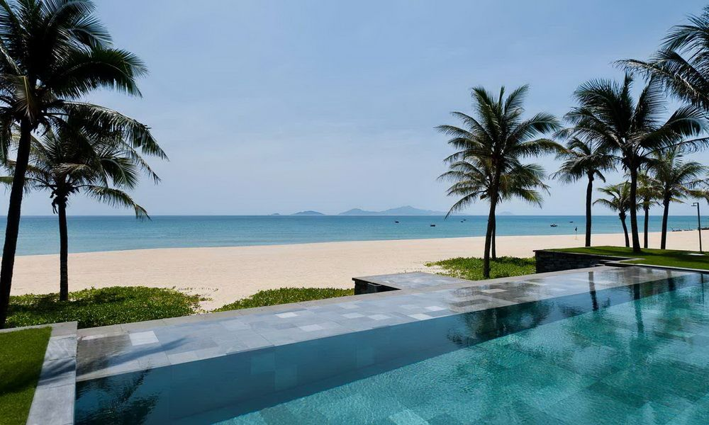 The Stunning Beach Front And Infinity Pools At Nam Hai Hotel Hoi An Vietnam