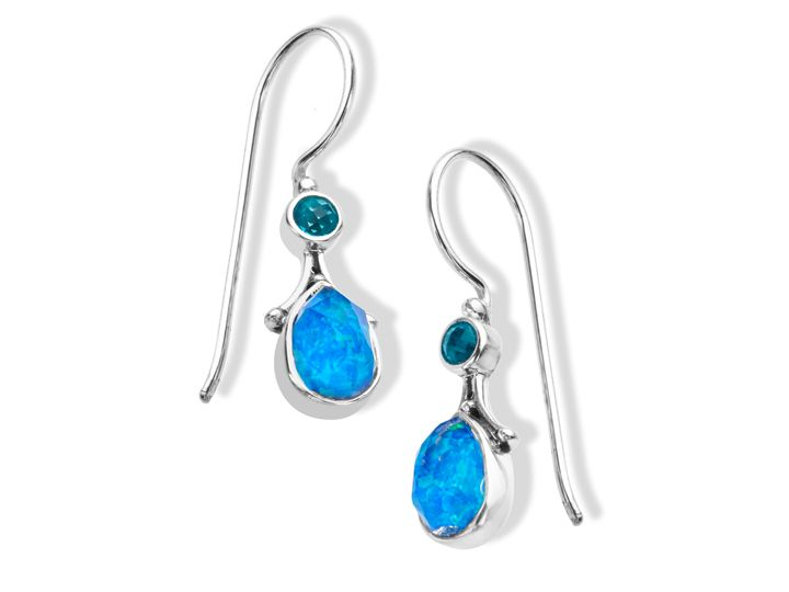 Delicate pieces are finished with signature Sajen detailing to become powerful in their own right.  Pear-cut Pacific blue opal quartz are combined with celestial paraiba quartz in beaded drop earrings crafted in sterling silver. Pieces measure 1 5/8 by 1/4 inches.