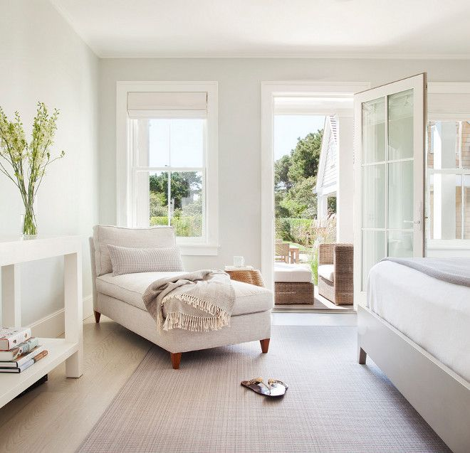 A calm and serene bedroom with walls painted Alaskan Husky by Benjamin Moore.  Come learn about the 12 Best Calm Paint Colors {Top Picks from Designers!} #paintcolors #benjaminmoorealaskanhusky #alaskanhusky #lightgreypaintcolors