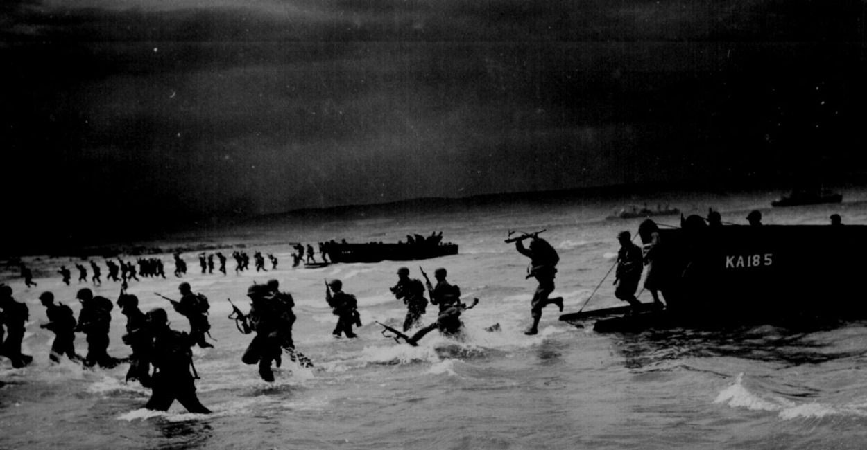 """""""From Coast Guard-manned 'sea-horse' landing craft, American troops leap forward to storm a North African beach during final amphibious maneuvers."""" James D. Rose, Jr., 1944."""
