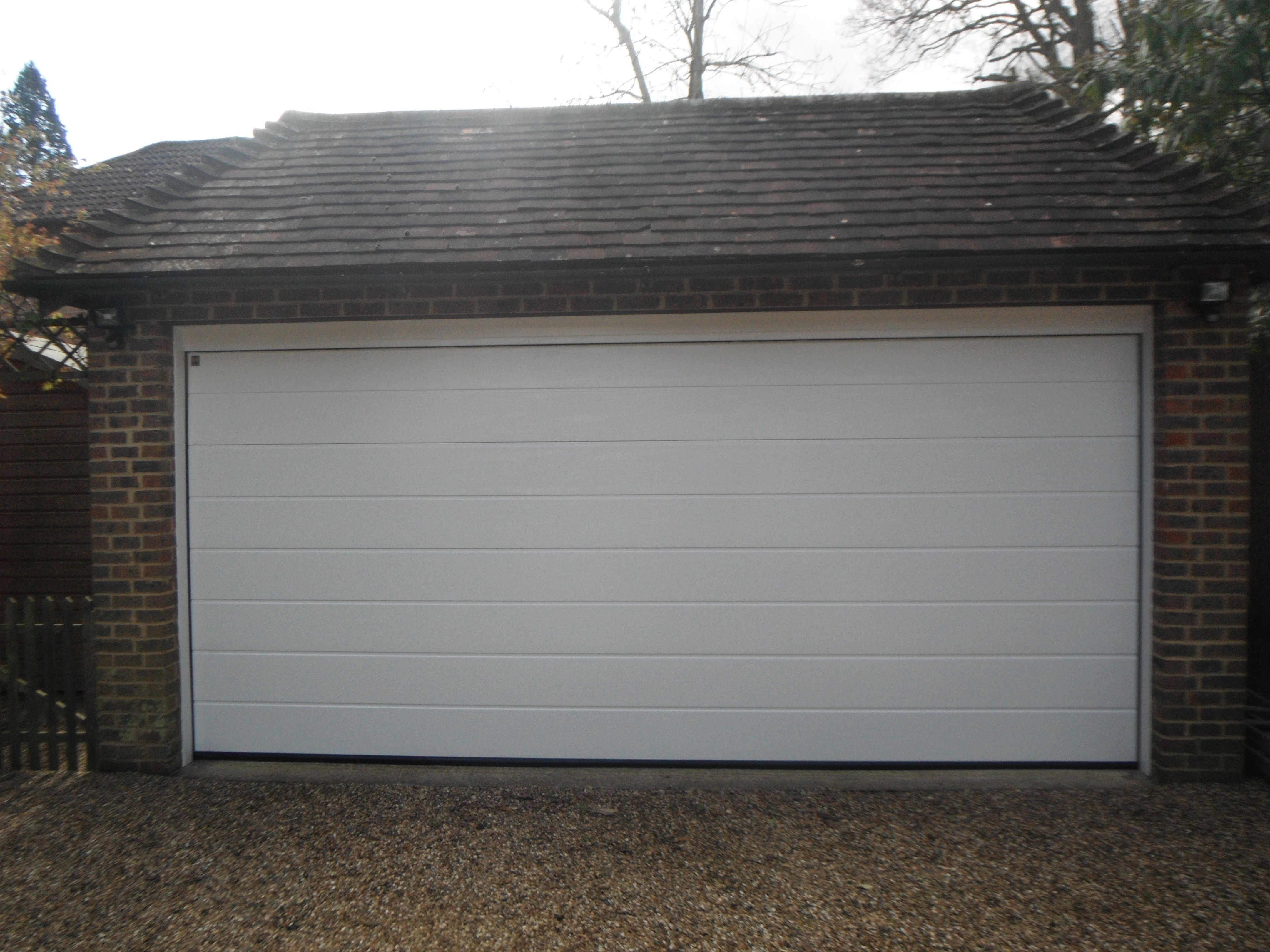 Hormann White M Ribbed Woodgrain Sectional Garage Door