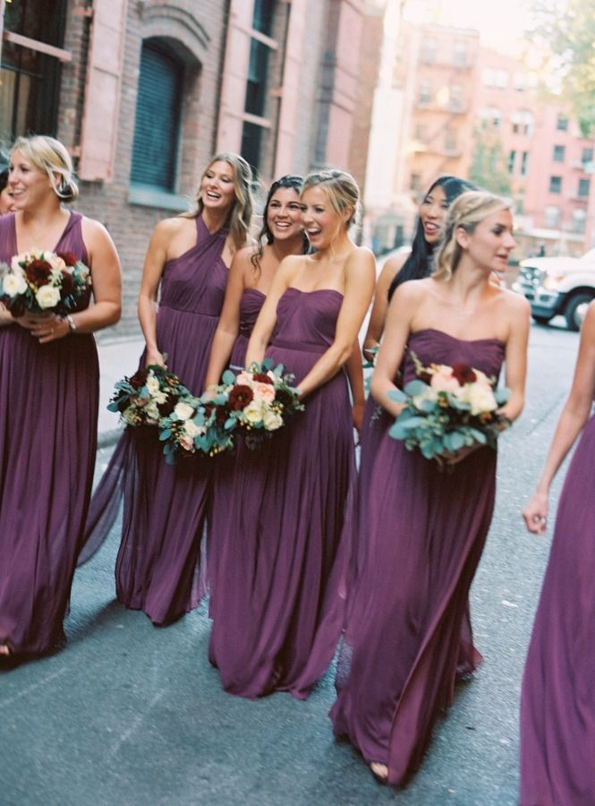ed82643e58 Perfectly purple bridesmaids in convertible bridesmaid dresses from David s  Bridal