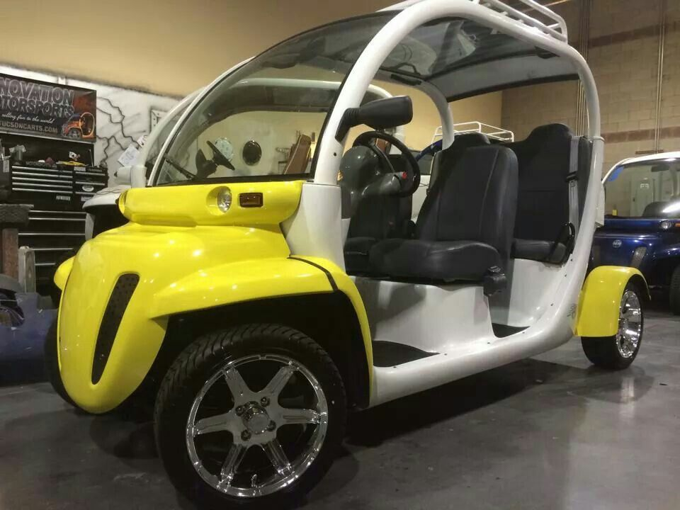 Custom yellow and white 4 seat Gem car by Innovation