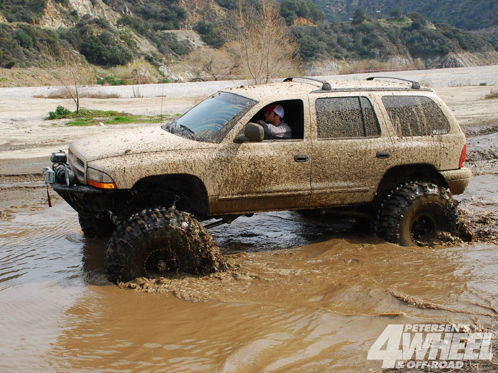1999_dodge_durango_muddingwater_plunge mudding lifted dodge ram trucks - Dodge Ram 1500 Lifted Mudding