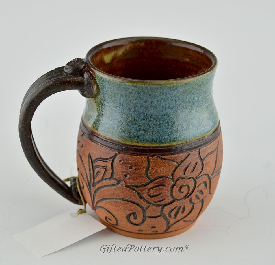 Pottery mug with a saying green blue carved brown