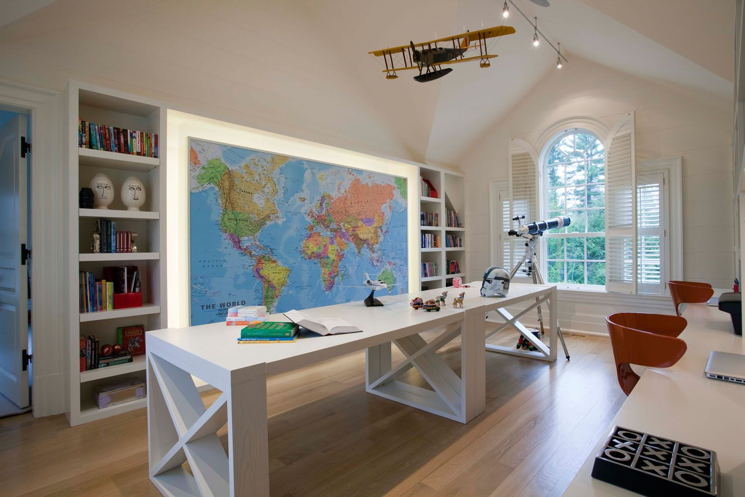 Love the bookshelves and the big map in this room Study room ideas