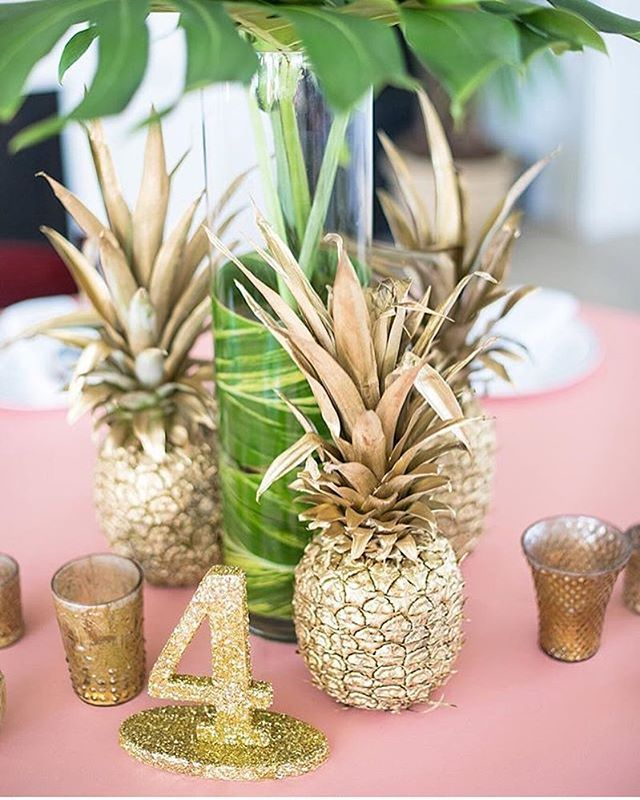 Gold pineapple centerpieces by the flower field were