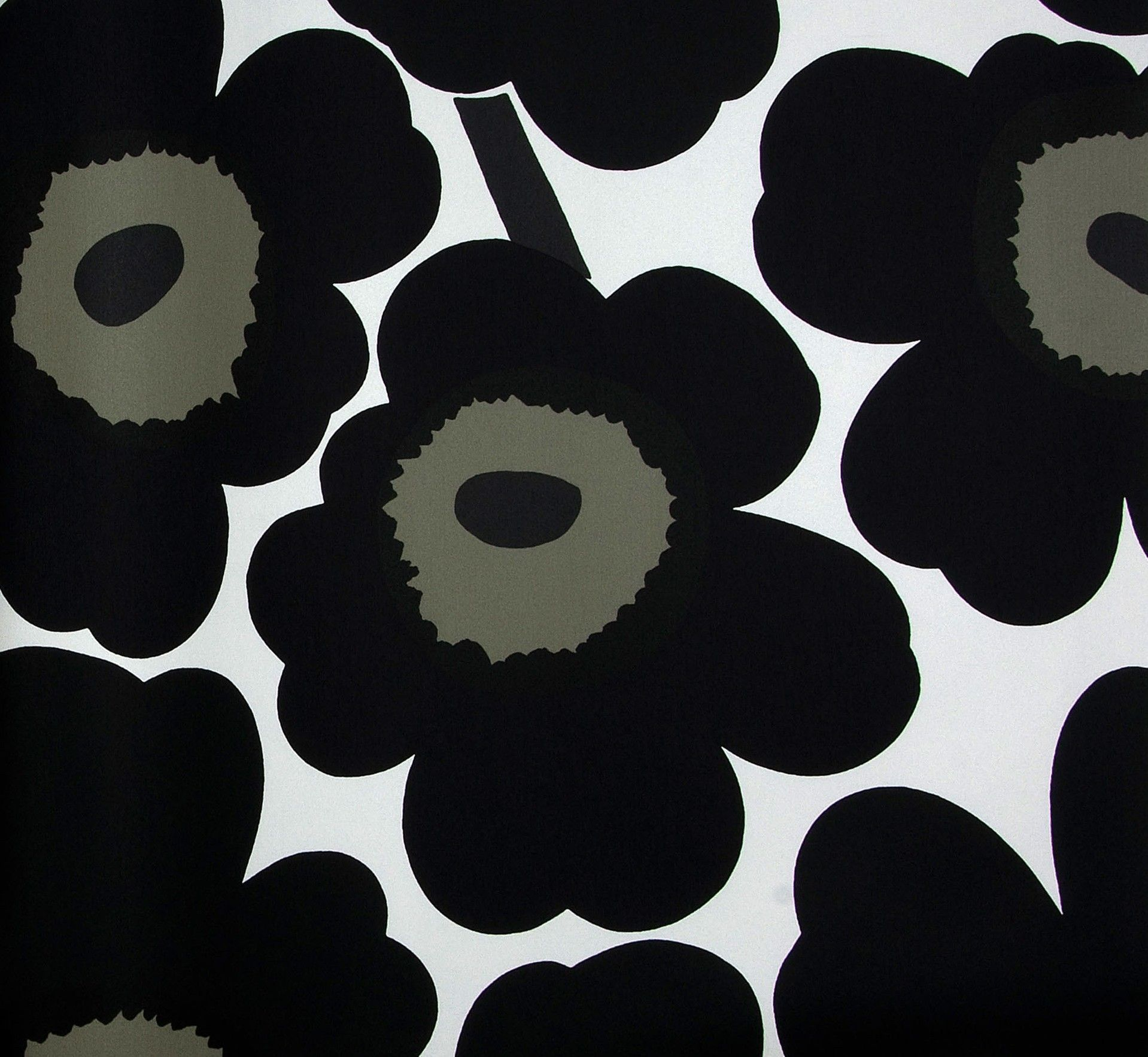Big and bold black florals on this wallpaper. Vintage