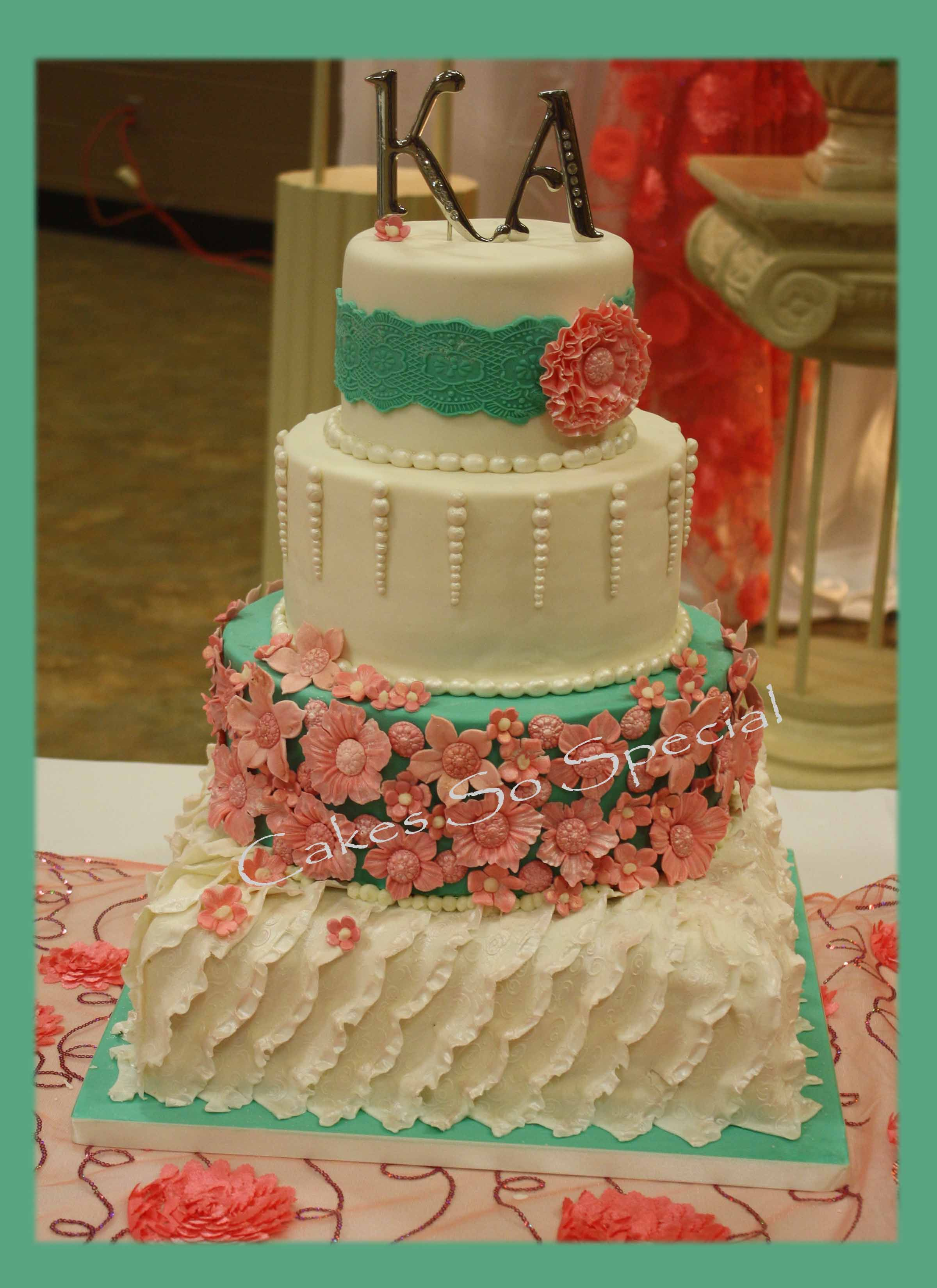Ruffled cake in with coral and aquamarine colorsa