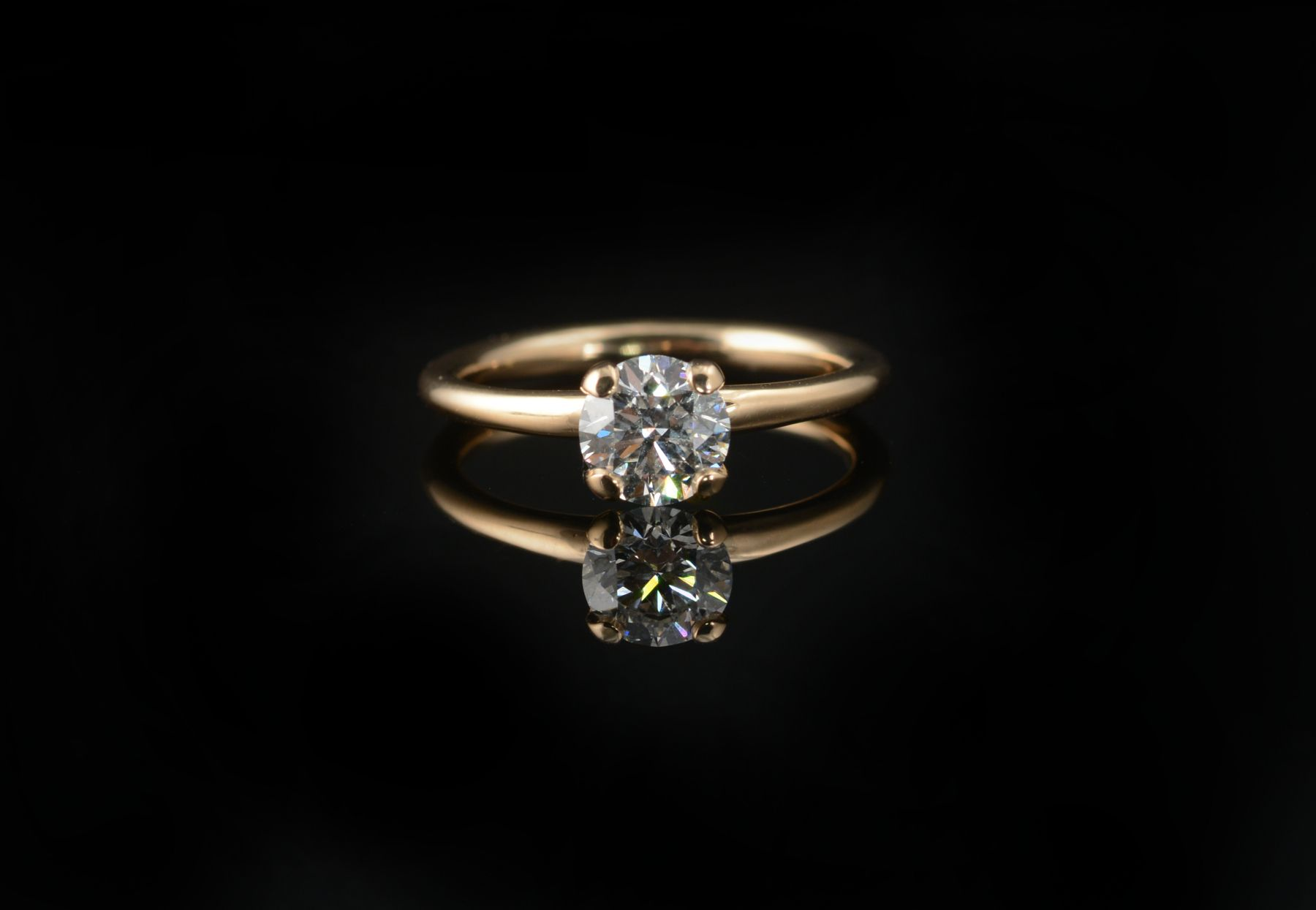 Four claw contemporary diamond and rose gold engagement ring