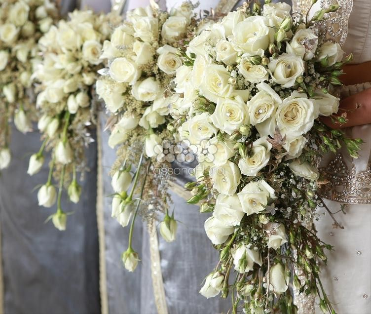 Beautiful Cream Roses Buds Gold Spray Gyp And Misty Teardrop Cascading Bouquets