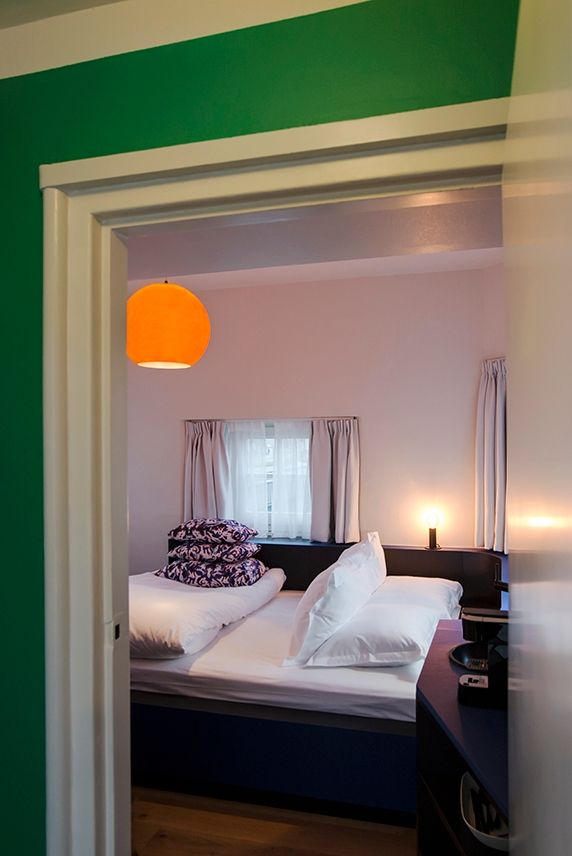 Old-Dutch meets modern in bridge house 306-Beltbrug. The bathroom is clad in classic tiles, while elements like the orange lamp by Tom Dixon give the space a contemporary feel.  #sweetshotel #amsterdamwest #amsterdam #hotel #hotels #hospitality #design #interior #unique #stays #getaway #unusual #travel #traveling #travelling #traveltips #destinations #destination #spaces #tomdixon #lighting #contemporary #modern #traditional #olddutch #windmill #dutch #design #staycation #hotelroom #hotelbed
