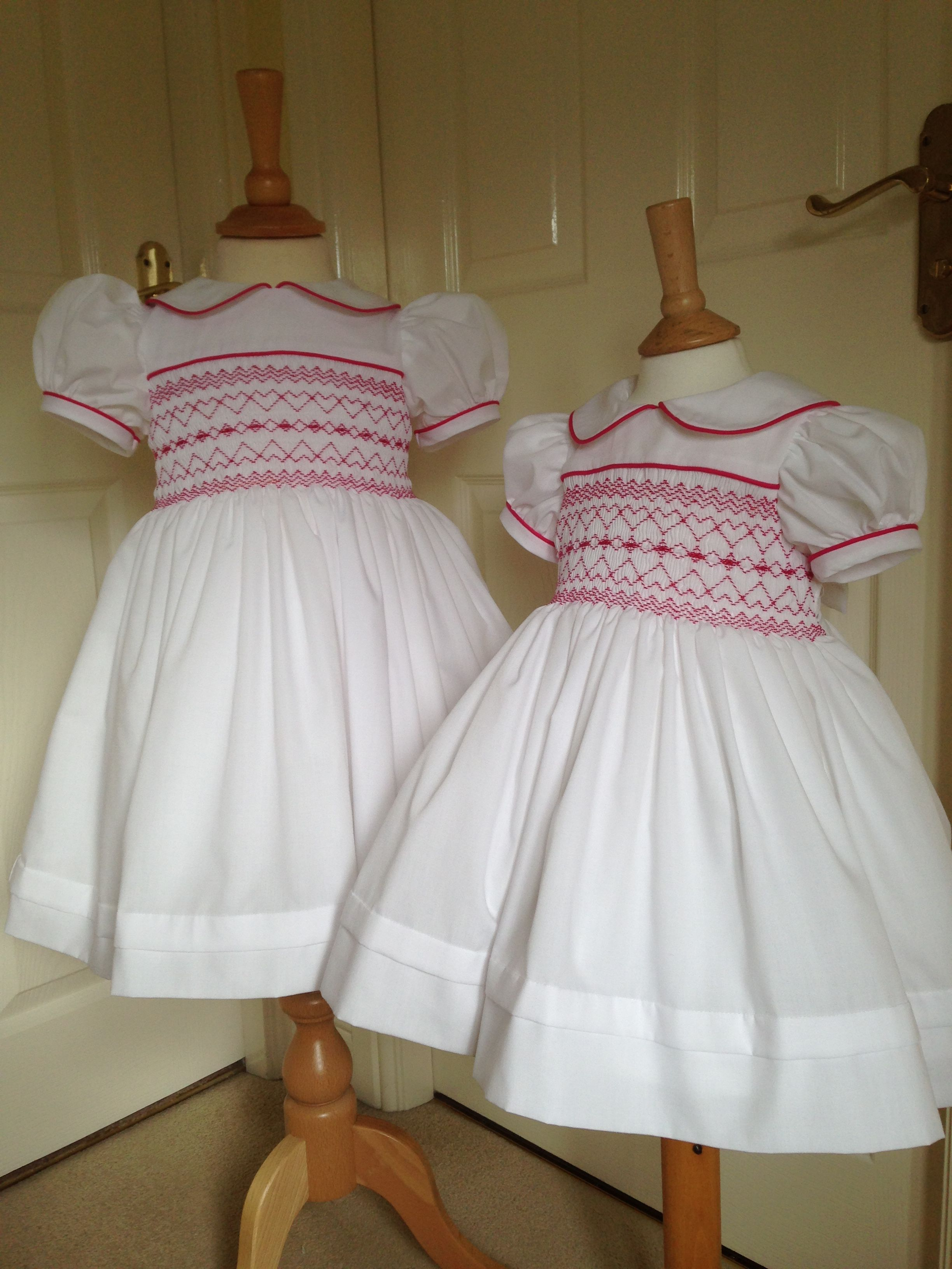 2854d2d9e4126 Two white and bright pink hand smocked dresses just completed ...