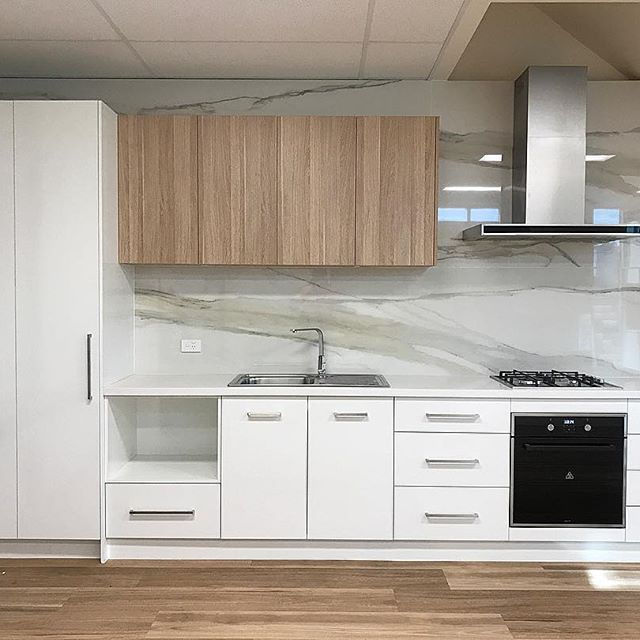 Our Showroom Apartment Kitchen Display Showcasing Polytec Polar White Sheen Base And Tall Cab White Kitchen Design Stone Benchtop Kitchen Kitchen Inspirations