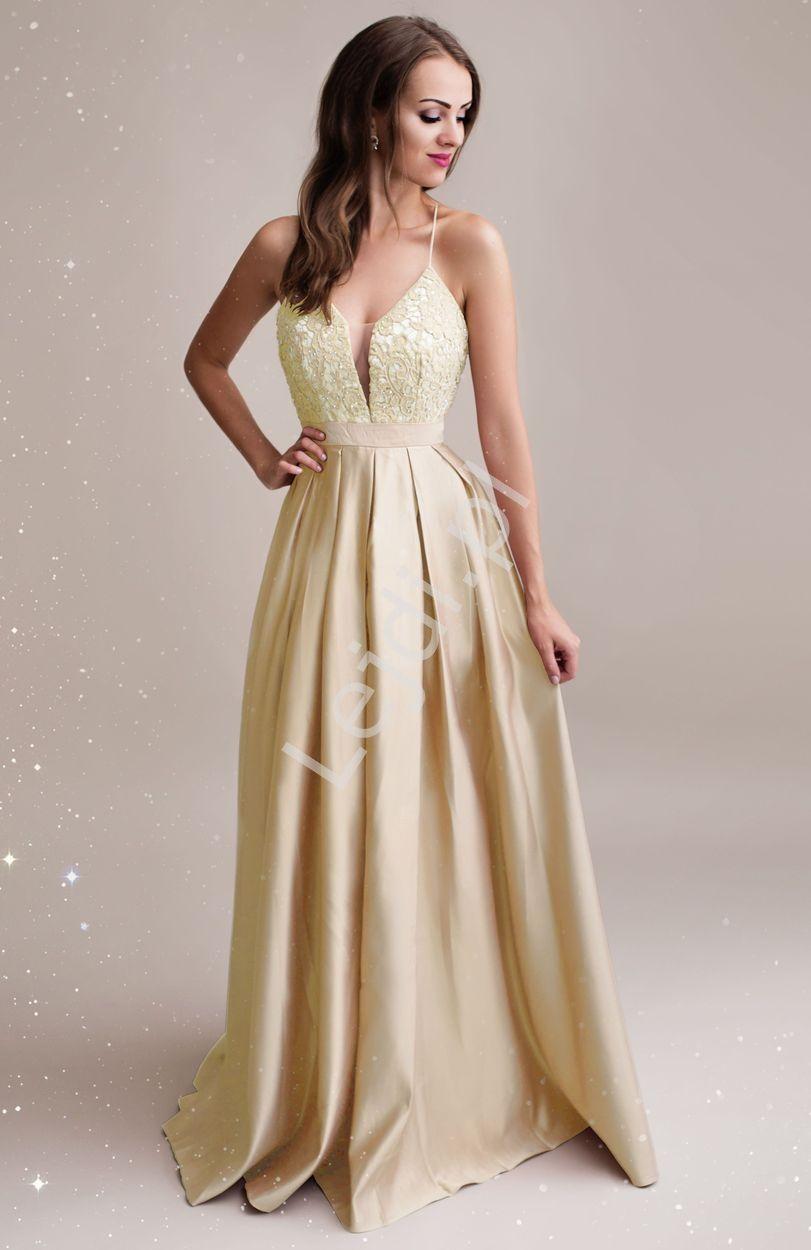 b3b7ba4991 Długa złota suknia wieczorowa zdobiona koronką i kryształkami. A long gold  evening dress decorated with