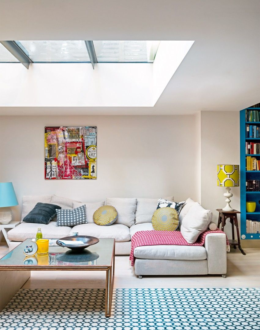 A L-shaped sofa creates a cosy area in this large open-plan living ...