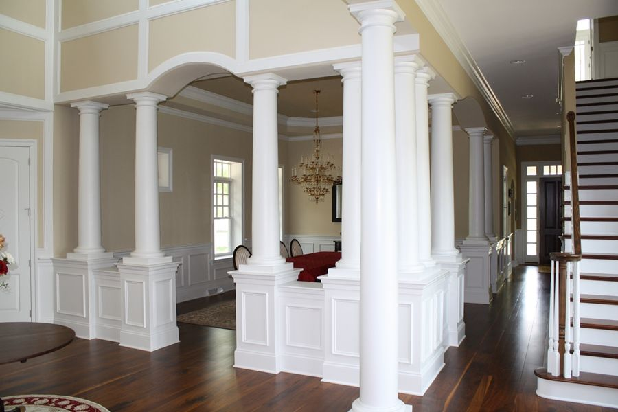 Formal dining room right off of the foyer with columns a Crown columns