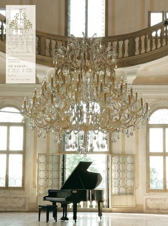 Black Grand Piano And A Beautiful Chandelier Elegant