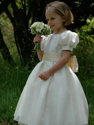 2c700947ec Romantic flower girl dress with striking box pleated skirt and puff sleeves  with button detail. The ready to wear version of the bridesmaid dresses we  ...