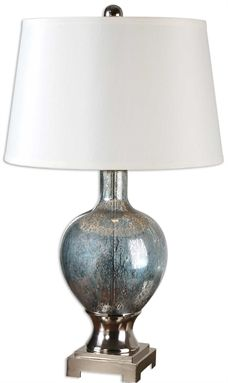 This Unique Table Lamp Features Mercury Blue Glass Accented With Polished Chrome Plated Metal Details The Round Slightly Tapered Hardback Shade Is White