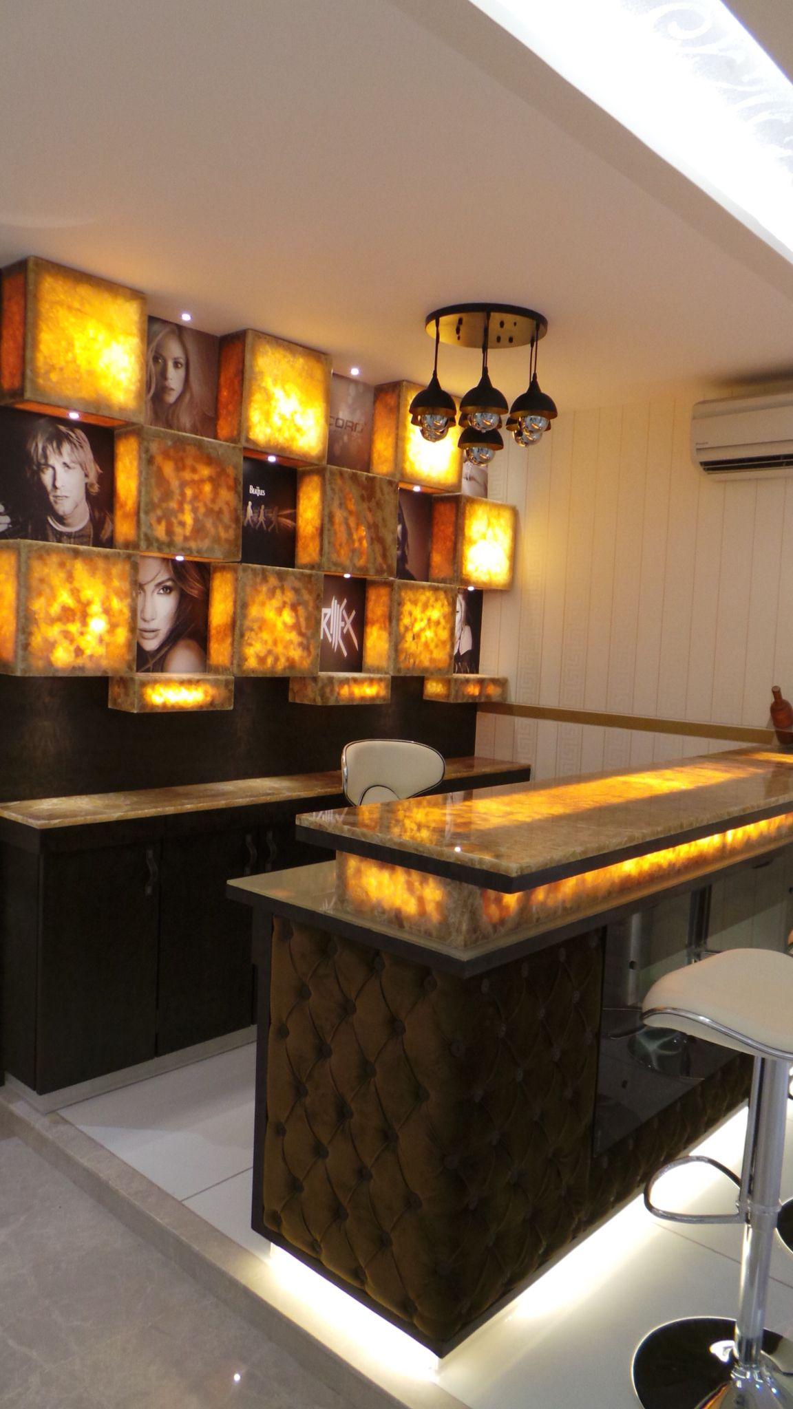 Onyx marble bar counter designed by sonivipuldesigns Residential bar design ideas