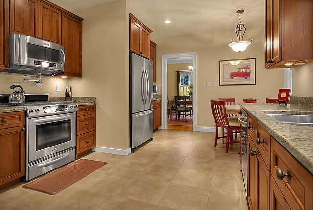 This kitchen is wonderfully functional and spacious after ...
